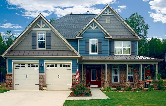 country-style home with different types of siding on different surfaces
